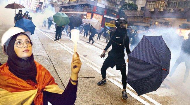 Hong Konglu genç eylemciler dün yine sokaktaydı.